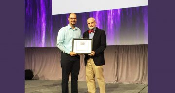 Glenn Landry Winning the AAIC 2016 Postdoc Poster Competition